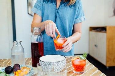 Woman preparing cocktail