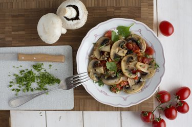 Fried mushrooms and tomatoes with coriander