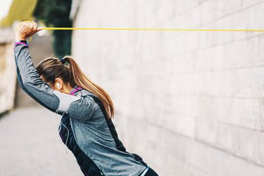 Woman training with resistance band
