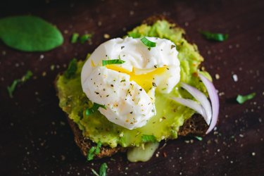 Avocado and poached egg sandwich, close up
