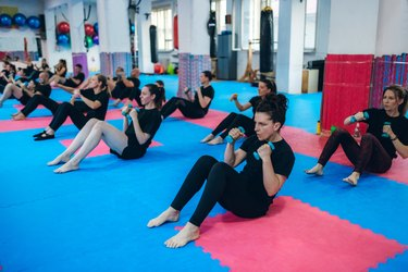 Fitness group doing abs