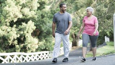 Couple Walking for Exercise Around Their Neighborhood