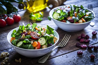 Two fresh salad bowls as an example of anti-inflammatory food for eczema