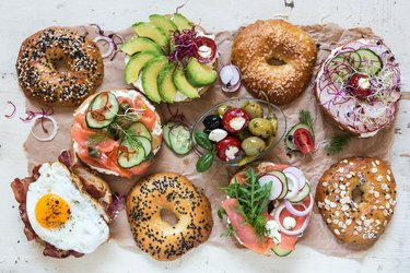 Top view of a variety of bagels with healthy toppings, as an example of food on a reactive hypoglycemia diet plan