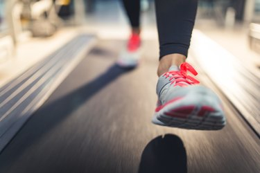 Close-up of Athlete shoes while running on treadmill