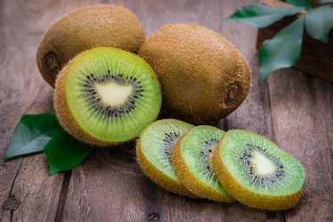 Kiwi fruit slices on wooden table