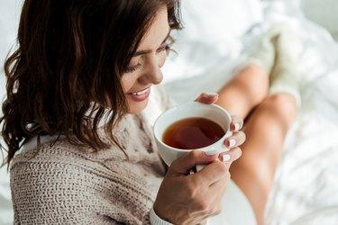 Woman drinking manzanilla tea.