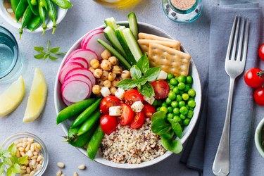 Healthy vegetarian salad. Buddha bowl. Grey stone background. Top view.