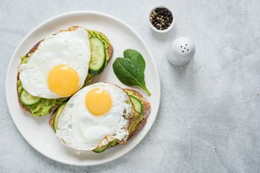 Two toasts with avocado, cucumber and egg