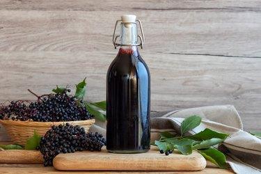 Black elder syrup, berries and leaves