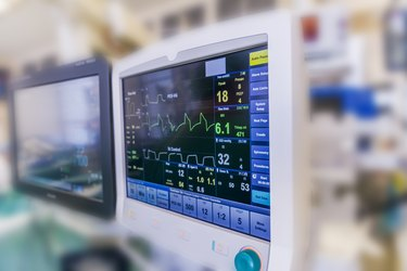 A hospital monitor at a patient's bedside