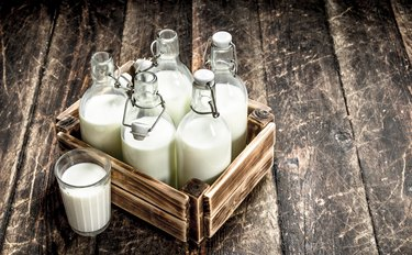 Bottles with fresh milk in a box.