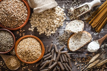 Wholegrain food still life shot on rustic wooden table