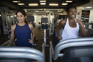 Women using treadmills in gym