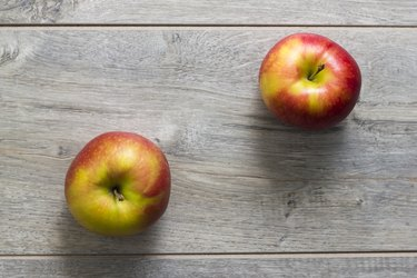 Two apples on wooden table