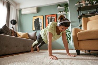 Woman performing push-ups.