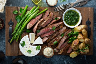 Sliced steak with asparagus and potatoes