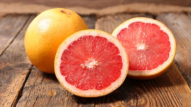 grapefruit on a wood background
