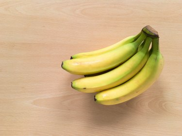 Directly Above Shot Of Bananas On Wooden Table