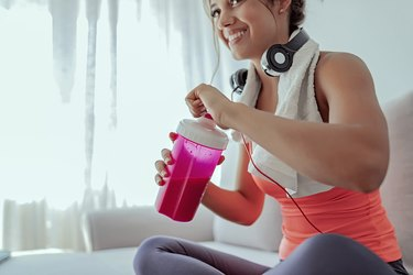 A female drinking a shake made with protein powder for her weight-loss diet