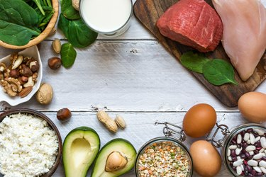 High protein food - chicken, meat, spinach, nuts, eggs, beans and cheese