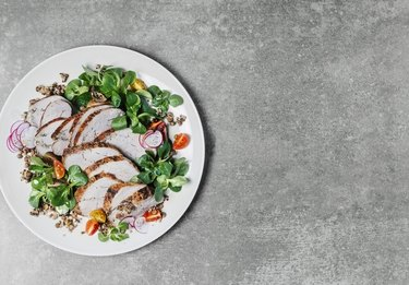Roasted pork with lentils and fresh salad