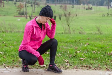 Young female athlete feeling lightheaded or with headache