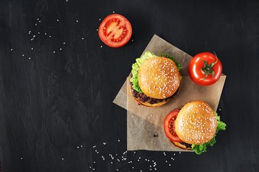 Craft beef burgers with vegetables.