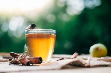 Hot glass mug of cinnamon tea