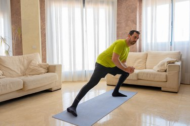 Man performing lateral lunge.