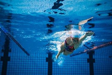 Underwater shot of female swimmer in action