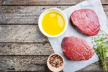 Raw marbled filet mignon steak