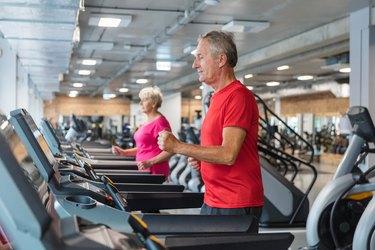 Senior people having rehabilitation at fitness club