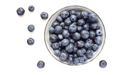 Directly Above Shot Of Blueberries Over White Background