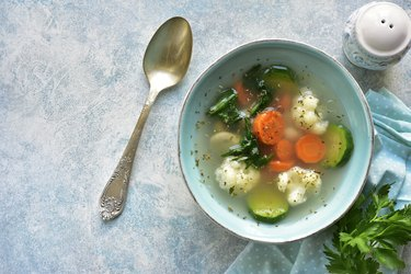 Vegetable soup with spinach, zucchini, carrot and cauliflower