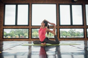 Woman doing pigeon yoga pose