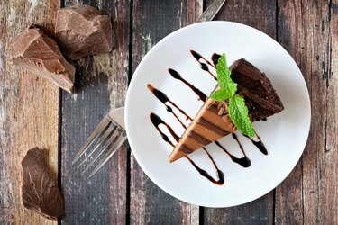 Chocolate cheesecake above view over rustic wood