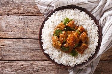 Indian food: Madras beef with basmati rice. Horizontal top view