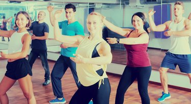 Adult people learning zumba steps