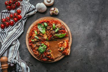 top view of delicious freshly baked pizza on concrete table