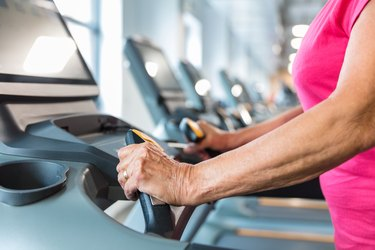 Senior woman workout on treadmill at gym