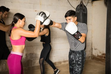 People training in a boxing gym