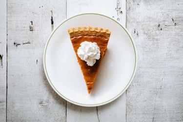 Pumpkin Pie Slice on Rustic Background