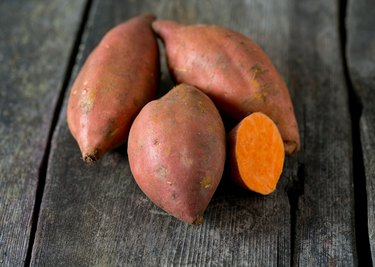 sweet potato on wooden surface
