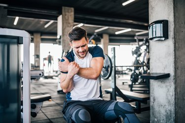 Man with shoulder pain doing exercises