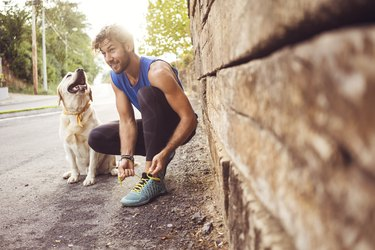 Man jogging with dog best friend