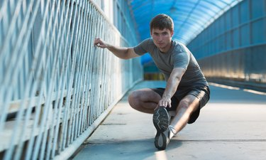 Man stretching outdoors in city
