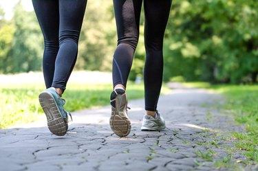 Female running feet in sport shoes