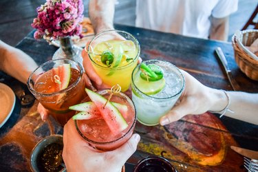 Friends toasting with healthy cocktails