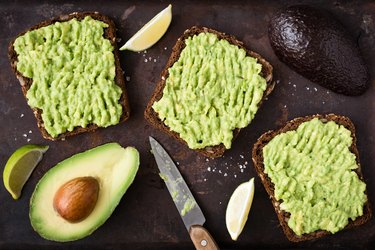 Avocado toast with whole-grain rye bread. Top view